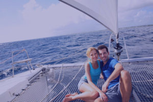 Happy couple on catamaran net
